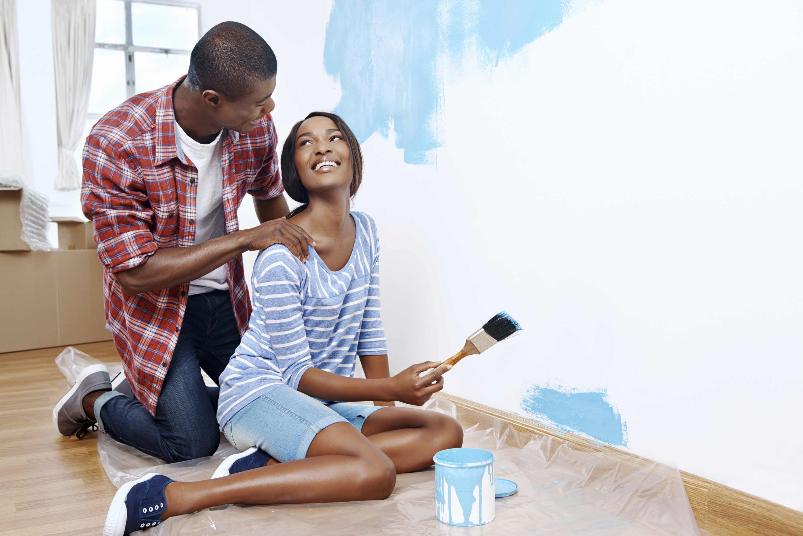 Young couple making Home Improvements
