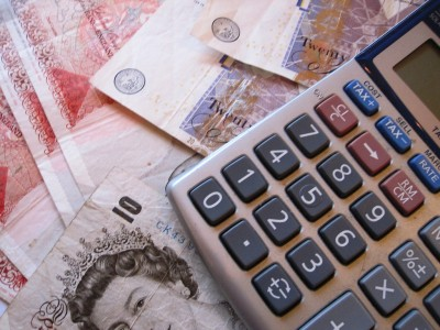 Cash and calculater for mortgage adviser